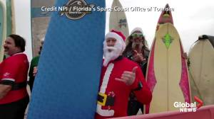 Surfing Santas hit the waves in annual Florida event