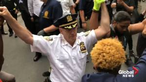 George Floyd death: NYPD Chief takes a knee alongside protesters in Washington Square Park (00:28)