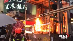 Hong Kong protester throws fire bomb at MTR station elevator (00:32)