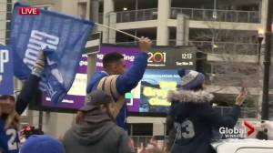 Blue Bombers' Andrew Harris celebrates during Grey Cup parade