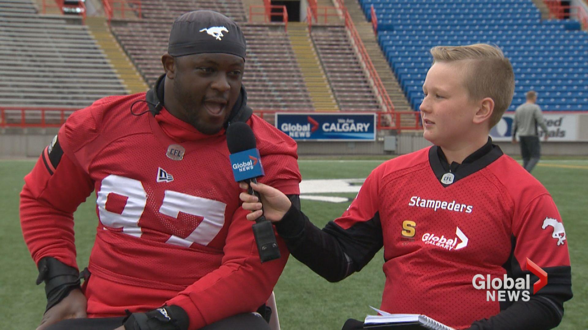 Junior reporter Malcolm interviews Stamps defensive lineman Derek Wiggan
