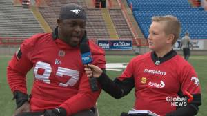 Junior reporter Malcolm interviews Stamps defensive lineman Derek Wiggan