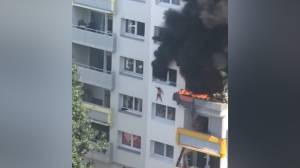 Children dropped from burning apartment in Grenoble caught by residents below (01:21)