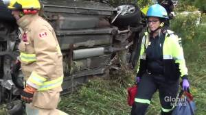 Woman trapped in rollover near Grafton