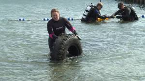 Dozens of volunteer divers gathered at the Gord Downie Pier to help clean-up the lake floor