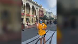 Masked staff welcome visitors as Disney's Magic Kingdom in Florida reopens
