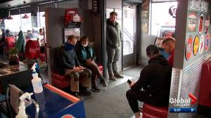 Calgary restaurant owner stays open despite new Alberta health rules (02:06)