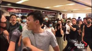 Protesters attack man in Hong Kong