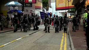 Hong Kong police make first arrests under new security law as thousands protest (02:23)