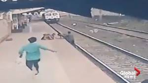 Railway employee in India sprints along tracks to save boy from oncoming train (00:59)