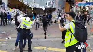 Hong Kong police shoot protesters during clashes