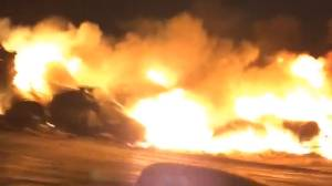Large flames burn after train derailment near Saskatoon