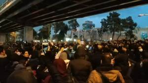 Families of Iran plane crash victims hold vigil in Tehran before protesters gather angry over incident