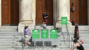 Pipers popping up around town, cheering up Montrealers