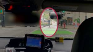 Video captures taxi in Vancouver separated bike lane