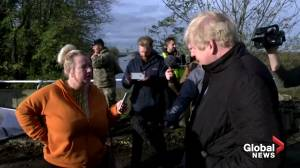 Boris Johnson receives frosty reception in flood-hit north