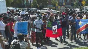 Asylum seekers who have worked during the pandemic protest new permanent residency deal (02:12)