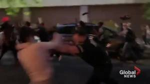 George Floyd death: Video appears to show police officer push protester in New York City