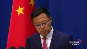 China says questioning of Australian journalists part of normal law enforcement (01:36)