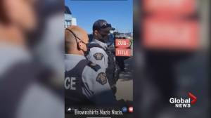 Dawson Creek RCMP yelled at by protesters as they arrest man outside city hall (00:28)
