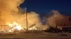 Flames burn after fire breaks out at condo construction site in Winnipeg
