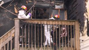 Community members rescue a man,  woman, and three children from burning building