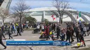 Thousands march in Montreal in protest of COVID-19 health measures (02:03)