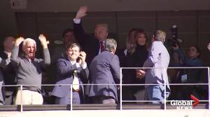 Trump receives warm welcome at Alabama university football game