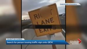 Halton police investigate video that shows sign being thrown onto QEW (01:17)