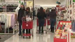 Shoppers brave crowds and COVID-19 risks for Black Friday bargains (02:06)