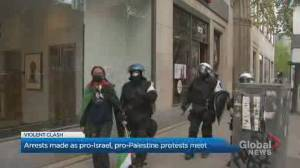 Pro-Israel and pro-Palestine demonstrators clash in downtown Montreal protest (00:34)