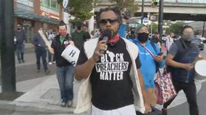 Angry crowd confronts controversial Toronto preacher