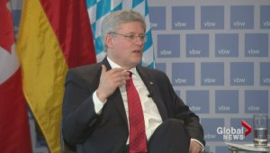 Harper slams Putin during Germany visit