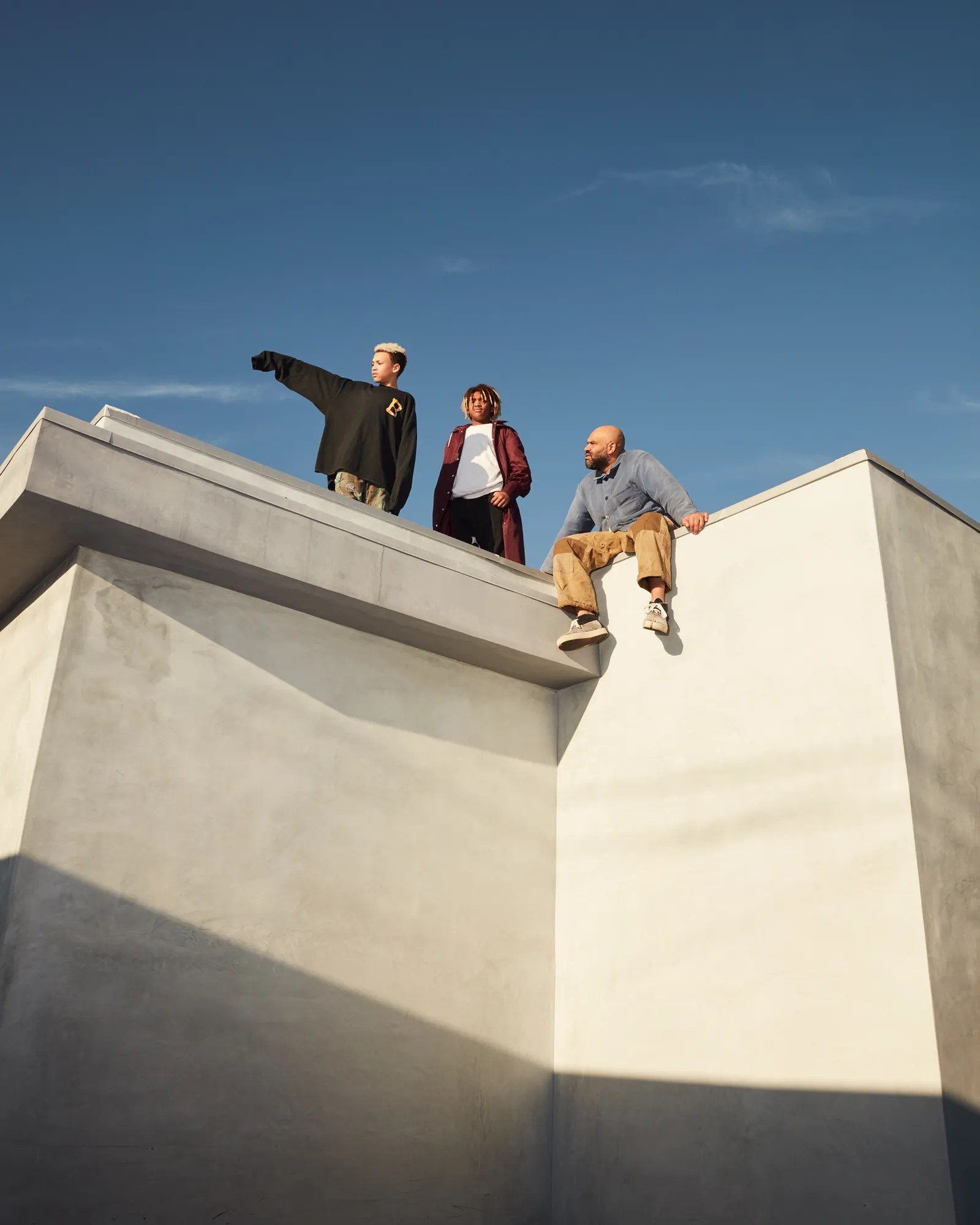 chris gibbs sitting on the roof with his sons