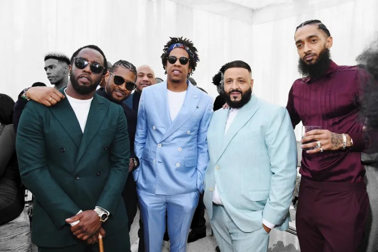 P.Diddy, Jay-Z, DJ Khaled, and Nipsey Hussle in bright suits