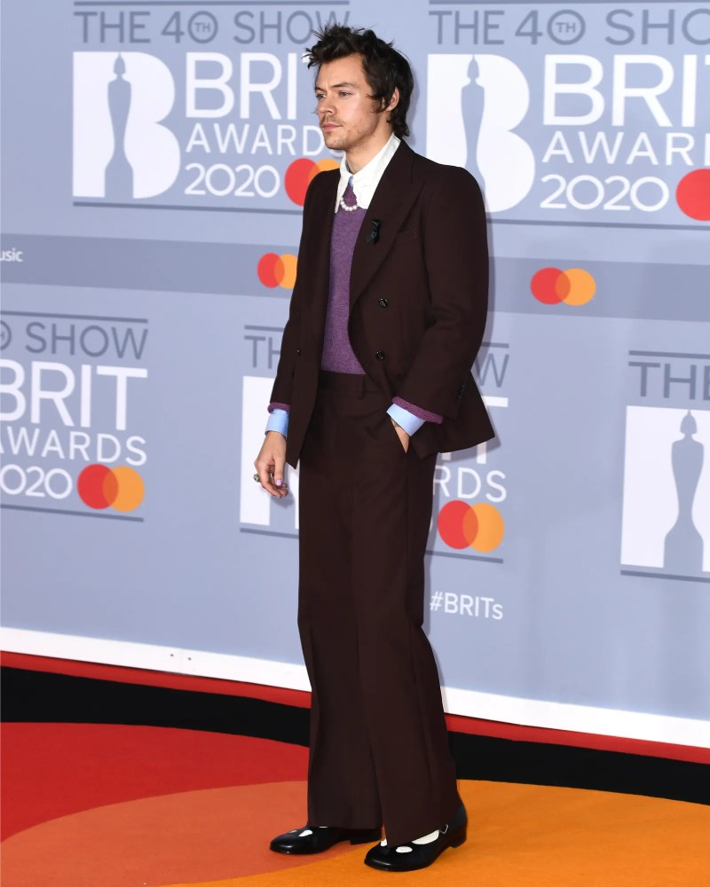 Image may contain Harry Styles Fashion Premiere Red Carpet Red Carpet Premiere Clothing Overcoat Apparel and Coat