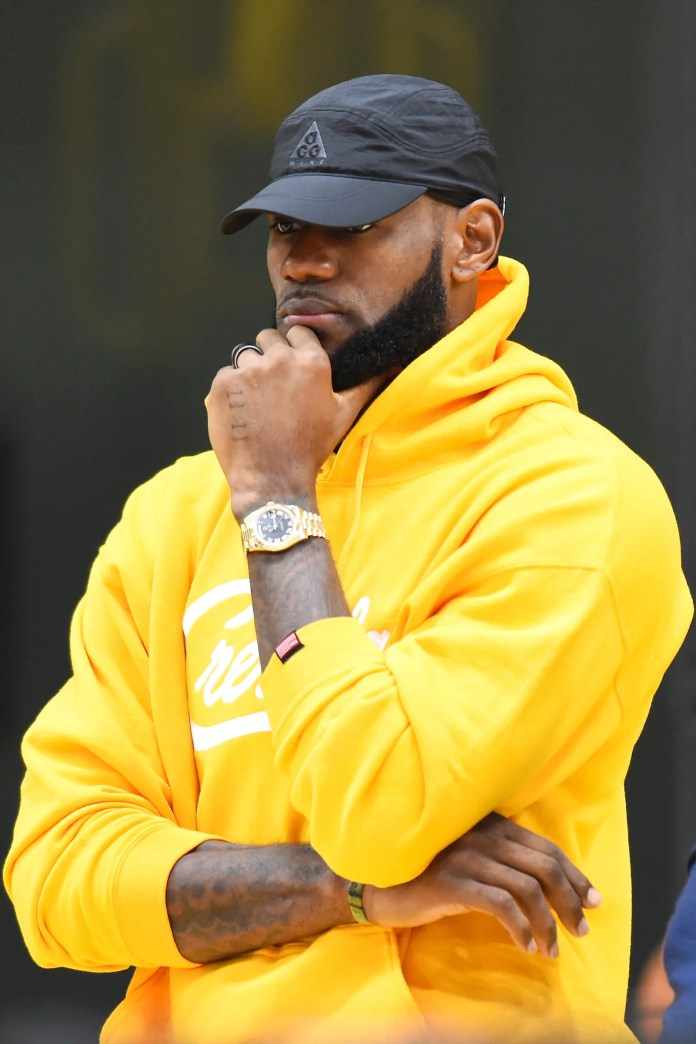 LeBron James looks on as General Manager Rob Pelinka and Head Coach Frank Vogel introduce Anthony Davis