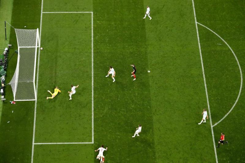 Jordan Pickford of England looks on as Ivan Perisic of Croatia's shot hits the post.