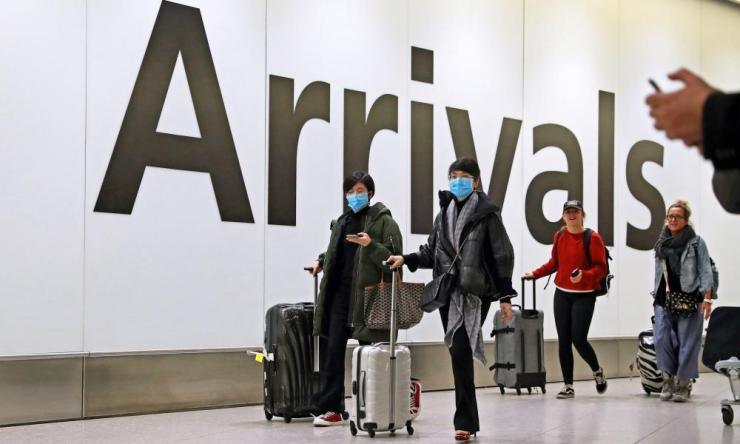 Passengers arriving in terminal 4 at Heathrow on Friday.
