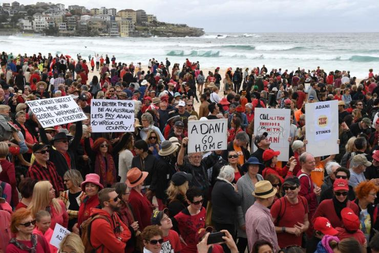 Anti-Adani protesters congregate on Sydney's Bondi beach.