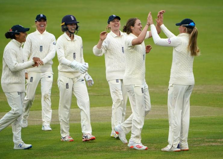 England's Nat Sciver celebrate after taking a wicket from India's Punam Raut.