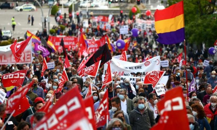 People march during a protest to mark the International Labour Day in Madrid, Spain, 1 May.