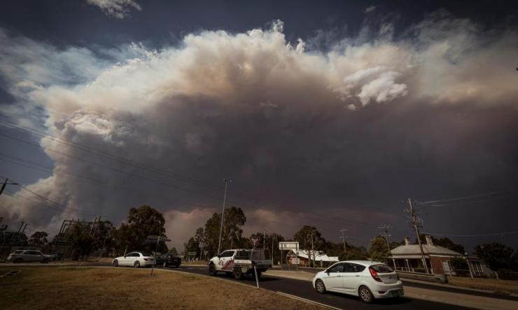 The 12km high smoke plume from the merged W Tree and Barmah Spur fires is seen from the north of Bairnsdale, Victoria.