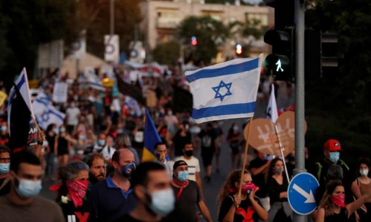 Israelis protest against prime minister Benjamin Netanyahu and his government's response to the financial fallout of the Covid-19 crisis in Jerusalem.