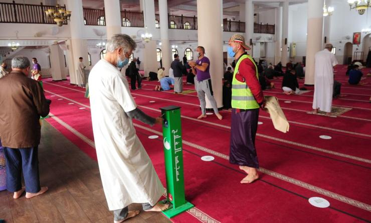 "Algerian Muslims gather at al-Falah Mosque to pray. The country has entered what the government describes as a ""concerning phase"" of Covid-19 spread."