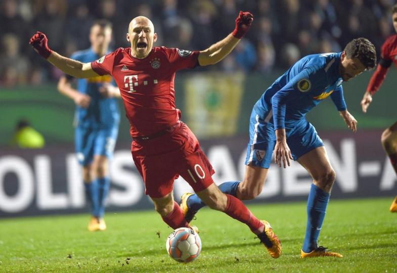 Going down? Bayern Munich's Arjen Robben takes a tumble.