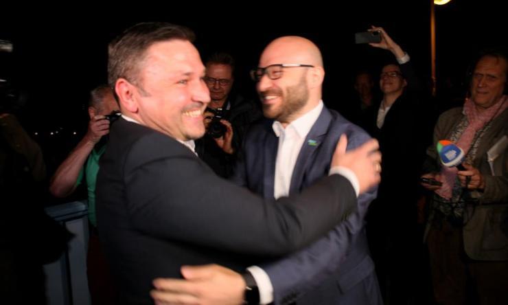 Mariusz Olejniczak (left) welcomes René Wilke in Słubice, western Poland.