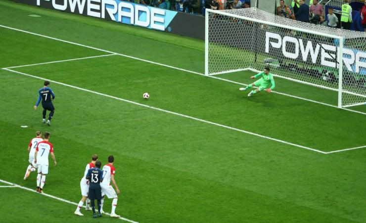 Griezmann slots home the penalty.