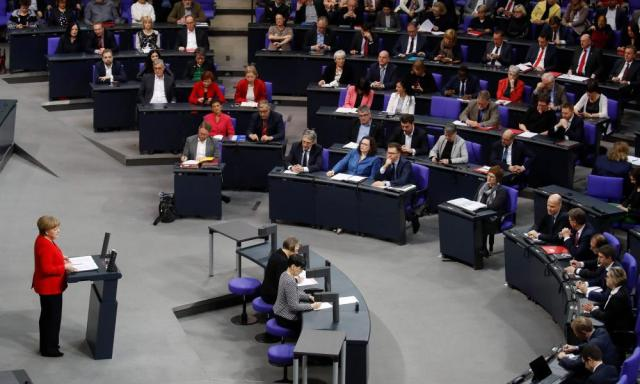 Angela Merkel addressing the German parliament this morning.