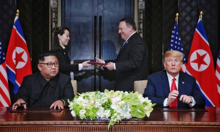 A document being exchanged between US Secretary of State Mike Pompeo and North Korean leader's sister Kim Yo Jong moments after it was signed by President Donald Trump and North Korean Chairmain Kim Jong-un